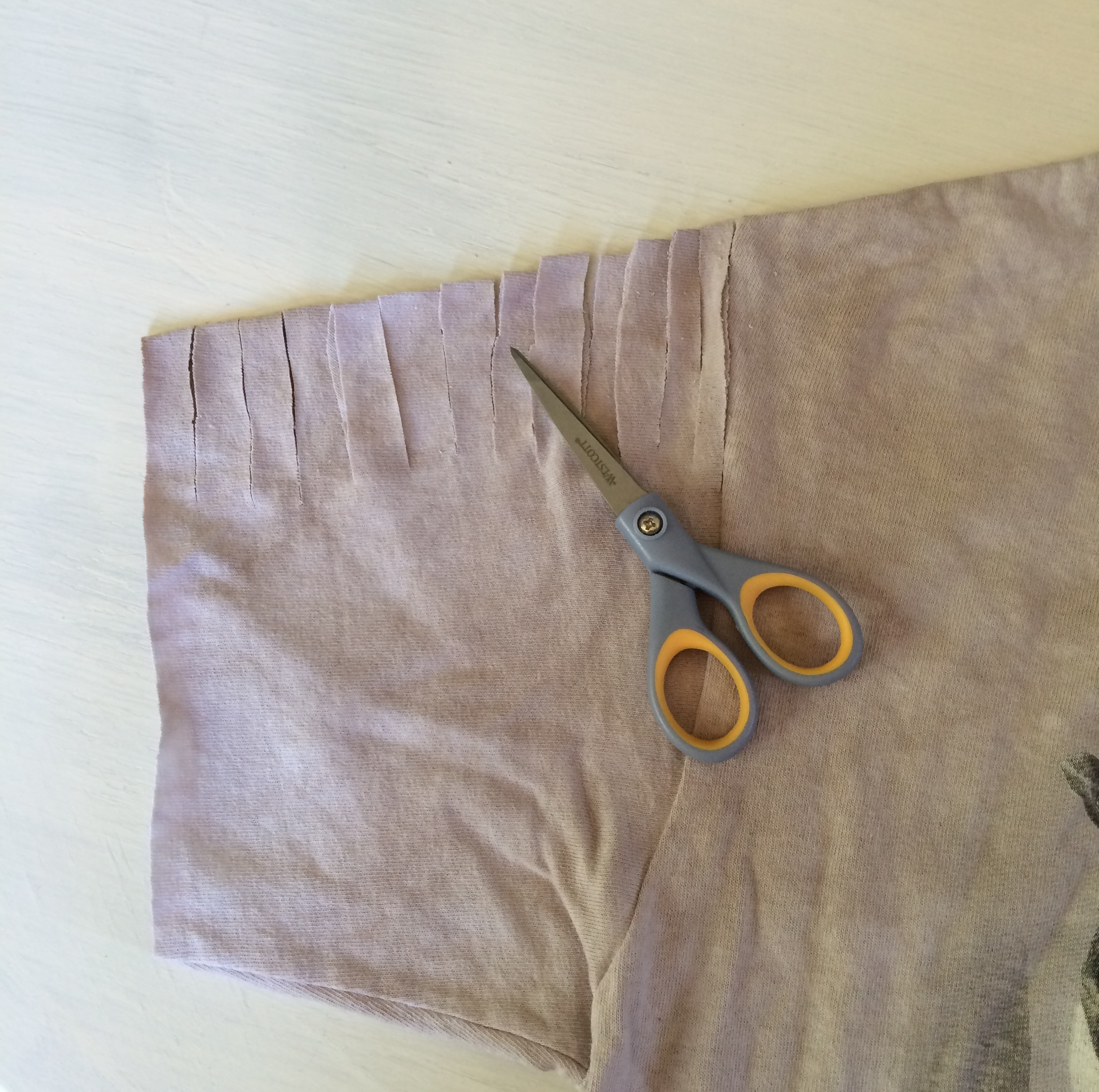2. Make even cuts along the top of the sleeve. It's up to you how deep you want to make the cuts.