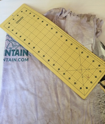 Take your cutting mat and angle it to make one side of the pyramid.